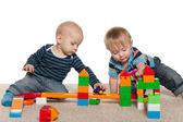 Two baby boys are playing — Stock Photo