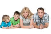 Family of four on the white background — Stock Photo