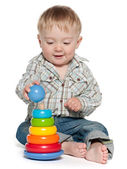 Cute baby boy is playing with toys — Stockfoto