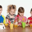 Children celebrate birthday at the table — Stock Photo #31012877