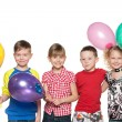Stock Photo: Four kids celebrate birthday