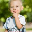 Curious baby boy in the summer park — Stock Photo #31014071