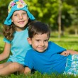 Boy and girl are resting in the park — Foto Stock