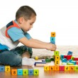 Clever preschooler is playing with toys — Stock Photo