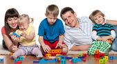 Family play on the floor — Stock Photo