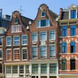 Historical buildings in Amsterdam — Stock Photo