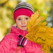 Young girl with yellow leaves — Stock Photo