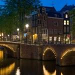 Bridges in Amsterdam at night — Stock Photo #34469019