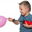 Little boy inflates a balloon — Stock Photo #34483073