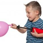 Little boy inflates a balloon — Stock Photo