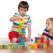 Stock Photo: Boys with blocks on the floor