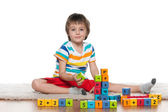 Clever little boy with blocks on the floor — Stock fotografie