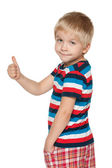 Cute boy holds his thumb up — Stock Photo
