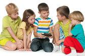 Group children plaing with a new gadget — Stok fotoğraf