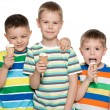 Boys eat ice cream — Stockfoto