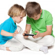 Stock Photo: Brothers plaing with a new gadget