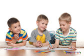 Little joyful boys draw on paper — Stock Photo