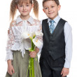 Handsome boy and pretty girl with flowers — Stock Photo