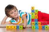 Preschool boy with blocks on the floor — Stock Photo