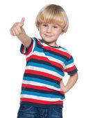 Joyful little boy holding his thumb up — Stock Photo