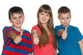 Children hold their thumbs up — Stock Photo