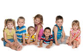 Seven children on the floor — Stock Photo