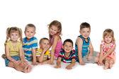 Seven children on the floor — Stock Photo