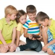 Children plaing with a new gadget — Stock Photo
