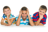 Three children with different emotions — Stock Photo