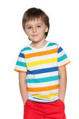 Cute pensive little boy in striped shirt — Stockfoto