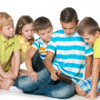 Group children with a new gadget — Stock Photo