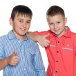 Stock Photo: Two boys hold their thumbs up