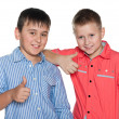 Two boys hold their thumbs up — Stock Photo