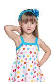 Pretty little girl in polka dot dress — Stock fotografie
