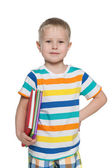 Young boy in striped shirt with books — Stock Photo