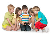 Children are playing with a new gadget — Stock Photo