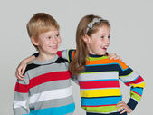 Cheerful children on the grey background — Stock Photo