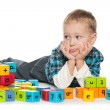 Pensive preschool boy with blocks — Stock Photo