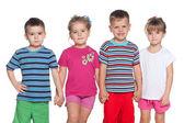 Four joyful children — Stockfoto