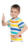 Cute little boy holds his thumb up — Stock Photo