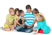Group of six children with a new gadget — Stock Photo
