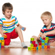 Two clever boys with blocks — Stock Photo #39189463