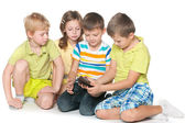 Kids plaing with a new gadget — Stock Photo