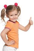 Girl in orange blouse holding thumb up — Stock Photo