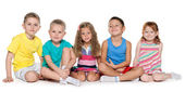 Sitting five cheerful children — Stock Photo