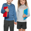 Young boy and girl with books — Stock Photo
