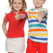 Stock Photo: Two cheerful children hold his thumbs up