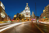 Alcala and Gran Via street in Madrid by night — Stock Photo