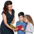 Mother and her children read book — Stock Photo