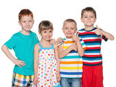 Four fashion cheerful children — Stock Photo